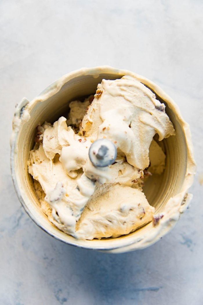 Freshly churned butterscotch pecan ice cream in the ice cream maker