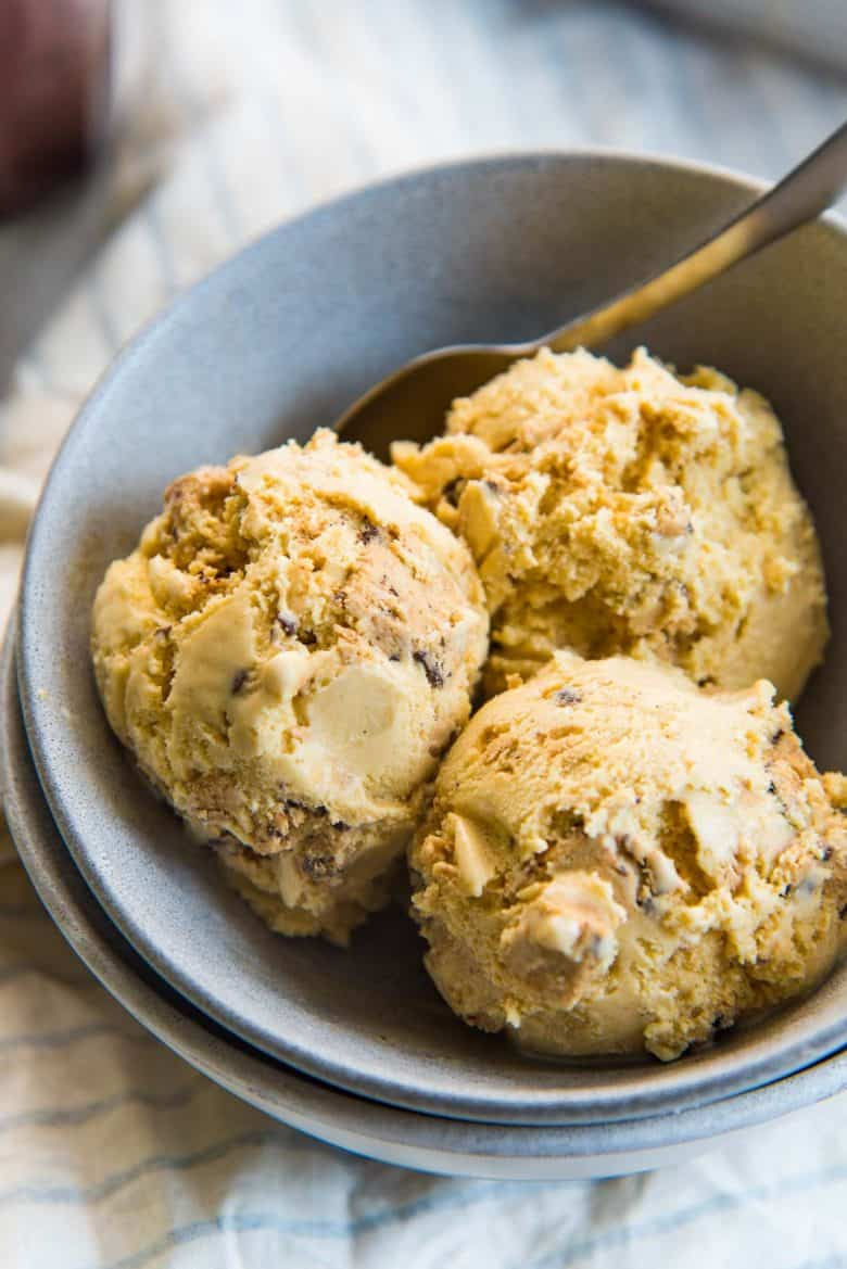 A close up of the ice cream, showing cookie dough pieces, in a grey serving bowl