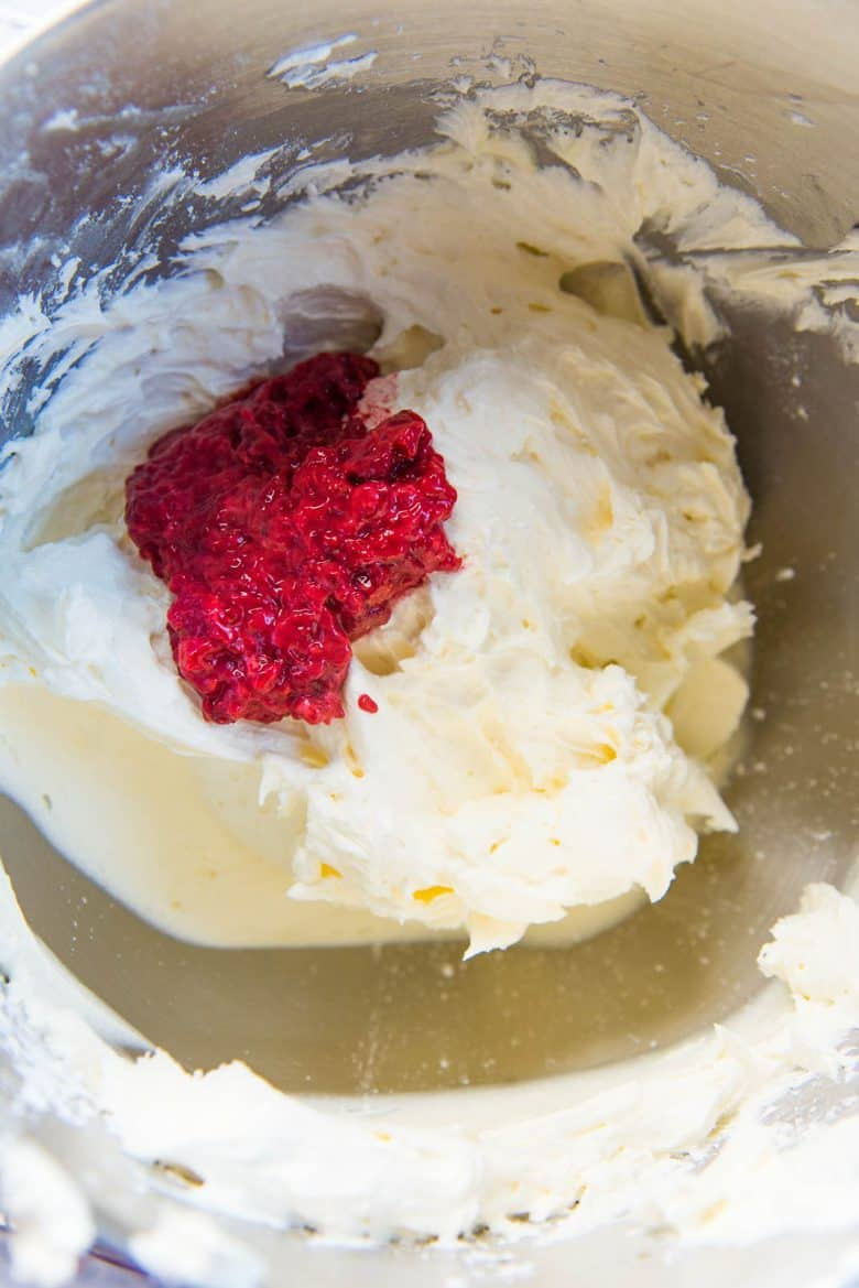 Raspberry pulp being added to the buttercream base.