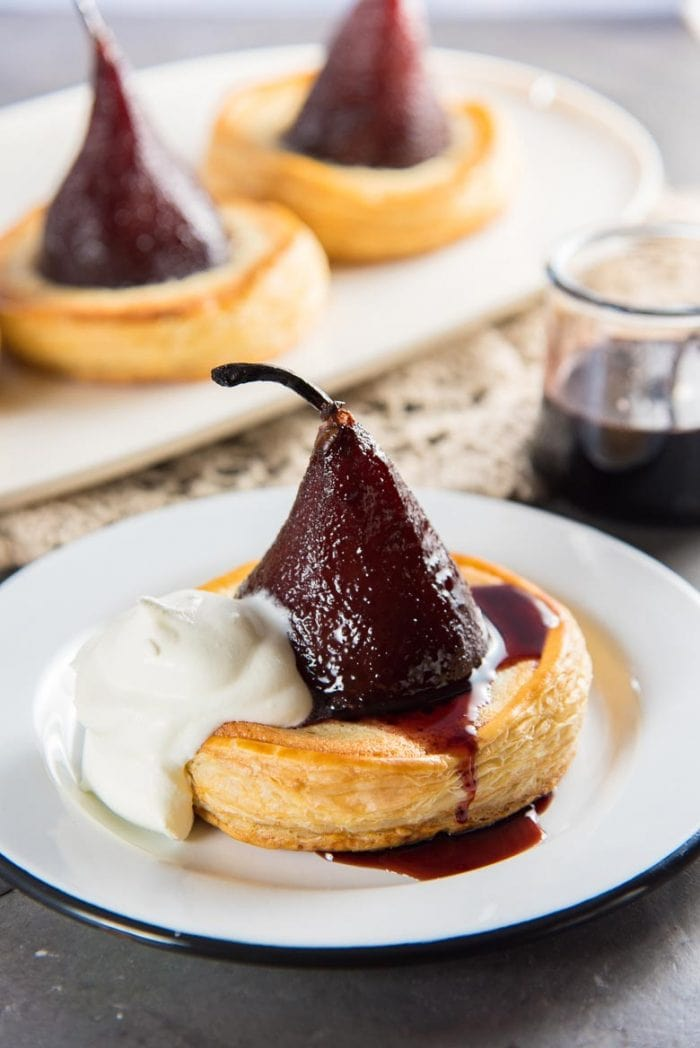 Serving suggestions for red wine poached pear tarts - with creme fraiche and wine syrup