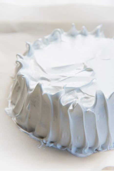 How to make pavlova - Creating furrows on the side of the pavlova to help with even baking.