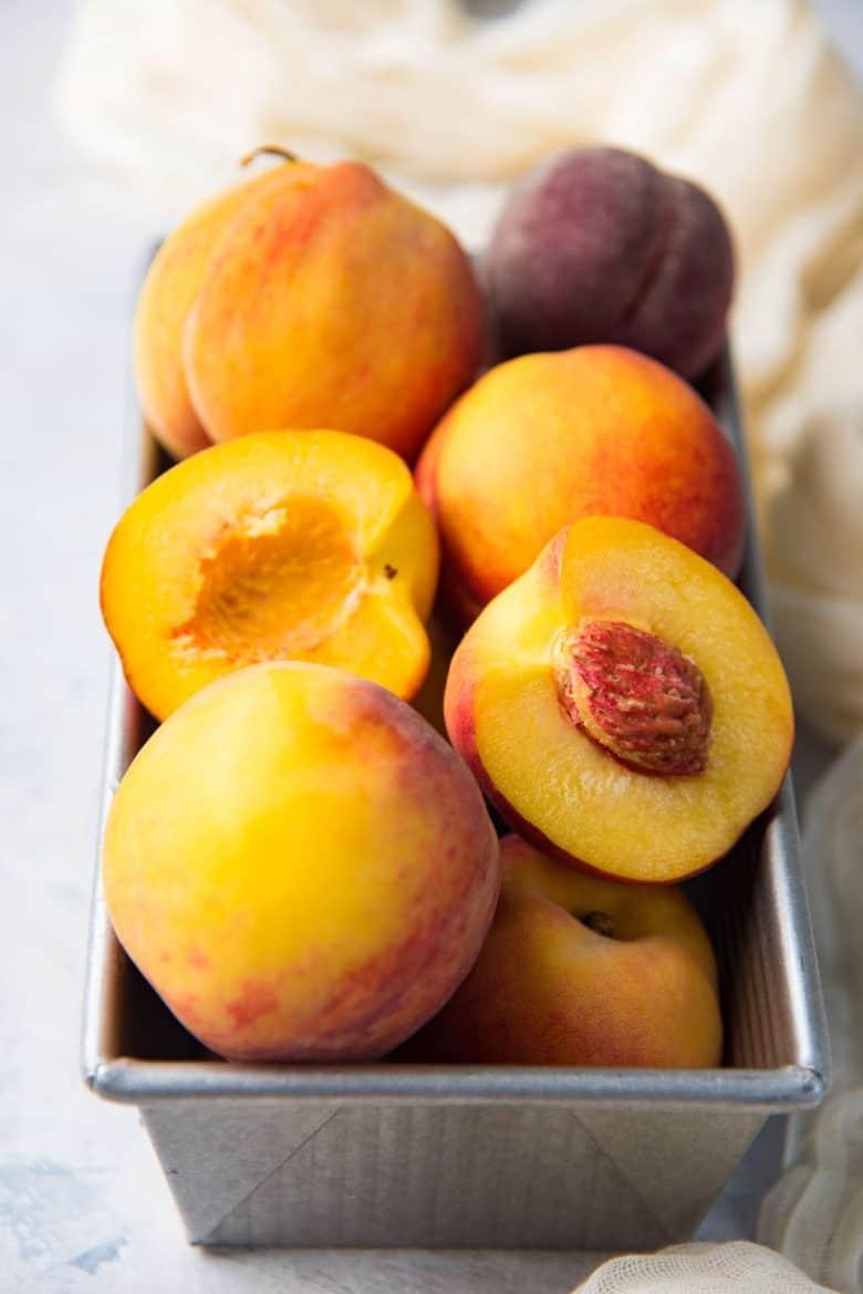Fresh ripe peaches in a pan