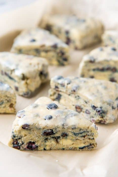 Frozen lavender blueberry scones on a parchment paper before baking