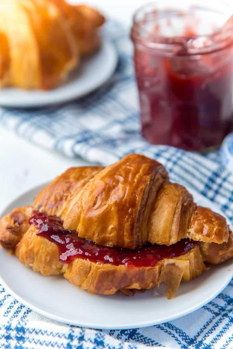 Spiced plum jam spread inside homemade croissant