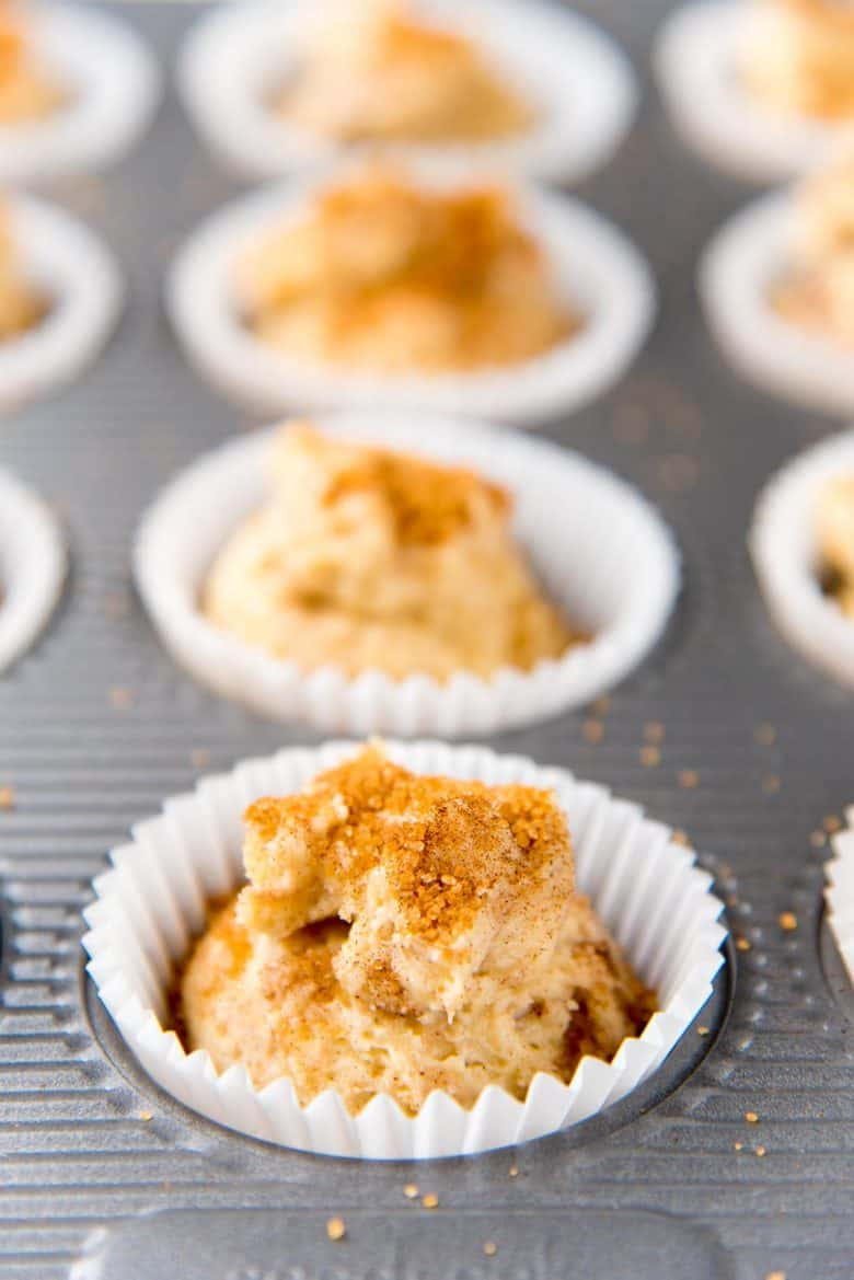Basic muffins spiced with cinnamon, unbaked in muffin cups