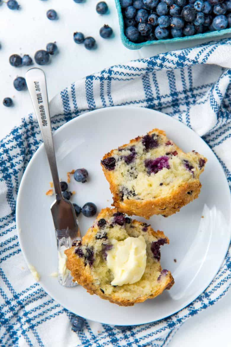 Split blueberry muffin with butter
