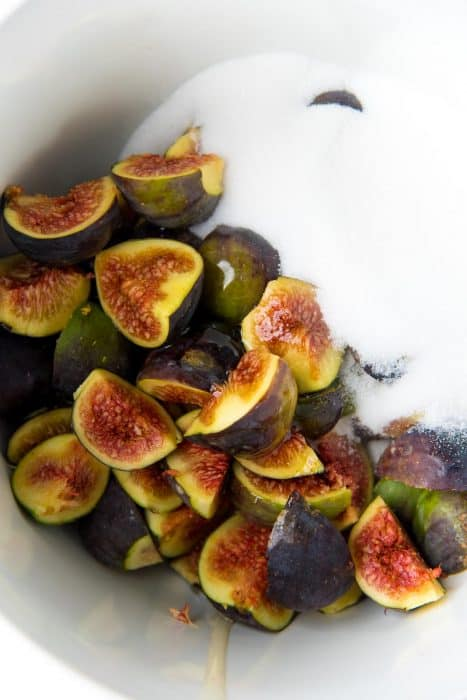 Figs and sugar in a large bowl