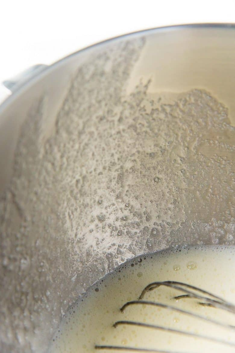 Sugar granules on the side of the bowl while being whisked