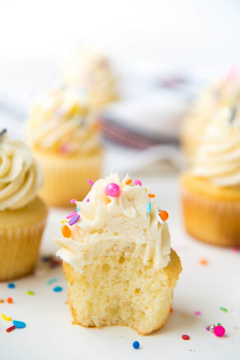 Vanilla cupcake with a bite taken