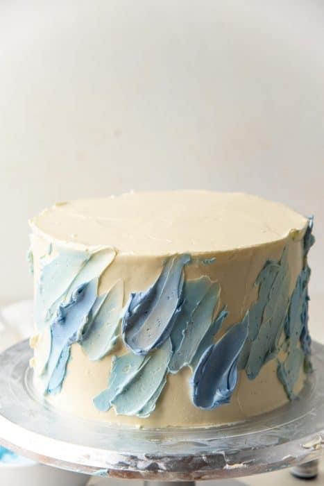 Spatula painting strokes with buttercream in different shades of blue and white