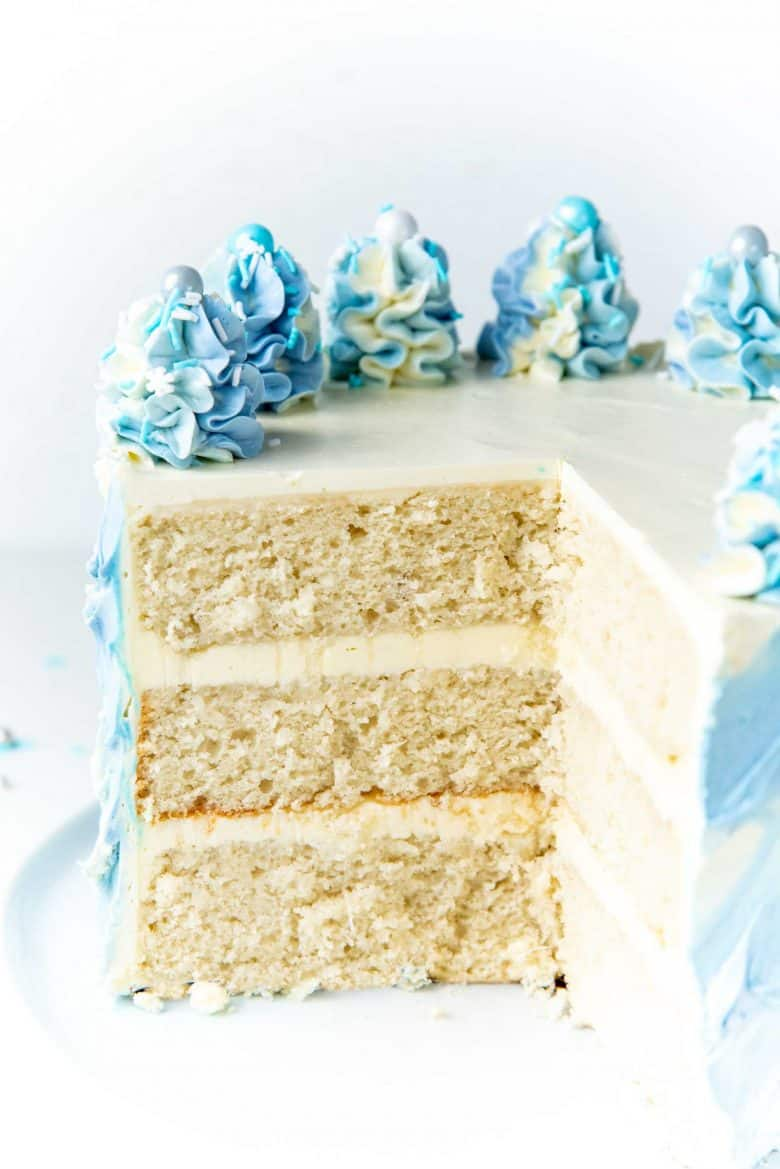 The cake slice cut out, showing the layers of the coconut cake.
