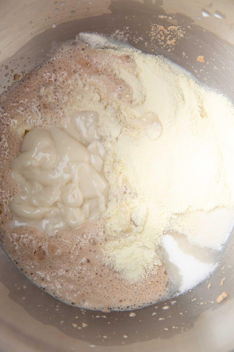 Adding all other ingredients to the activated yeast to make Japanese milk bread