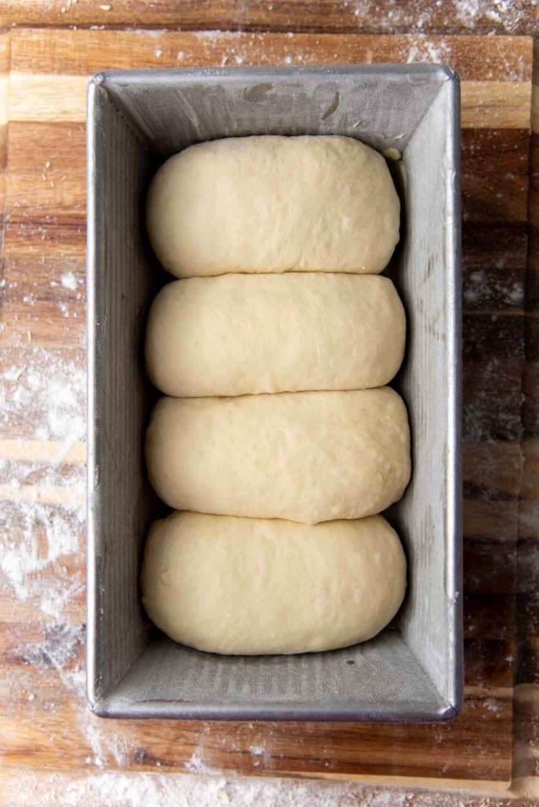 Bread rolls in the loaf pan.