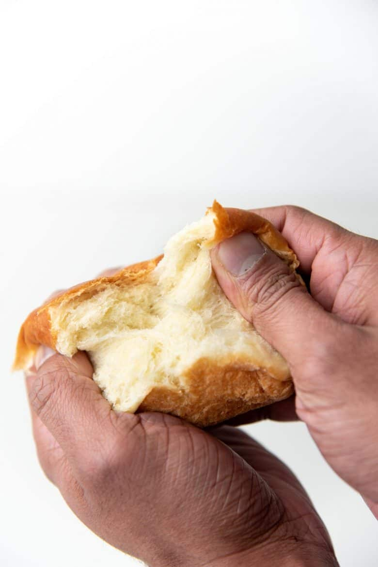Pulling apart a dinner roll
