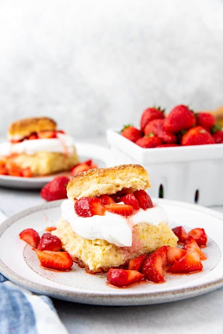 An assembled Strawberry shortcake on a grey plate