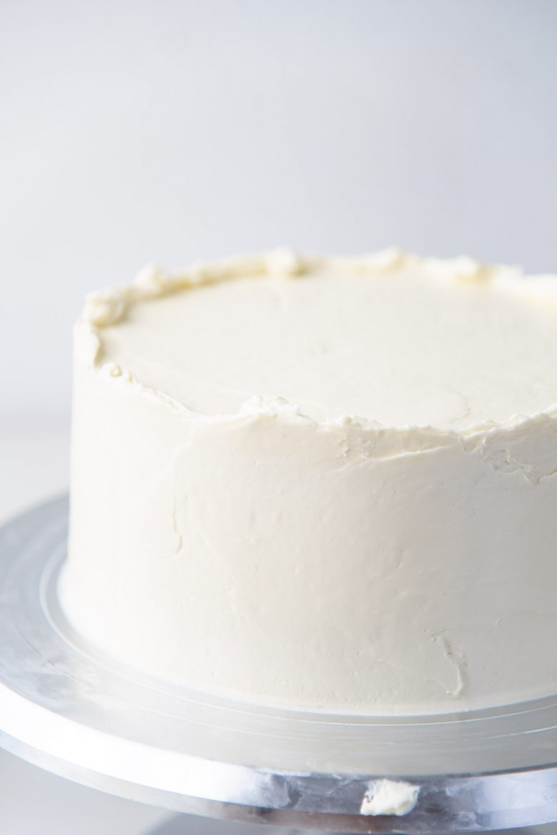 Smoothen the buttercream on the sides of the cake
