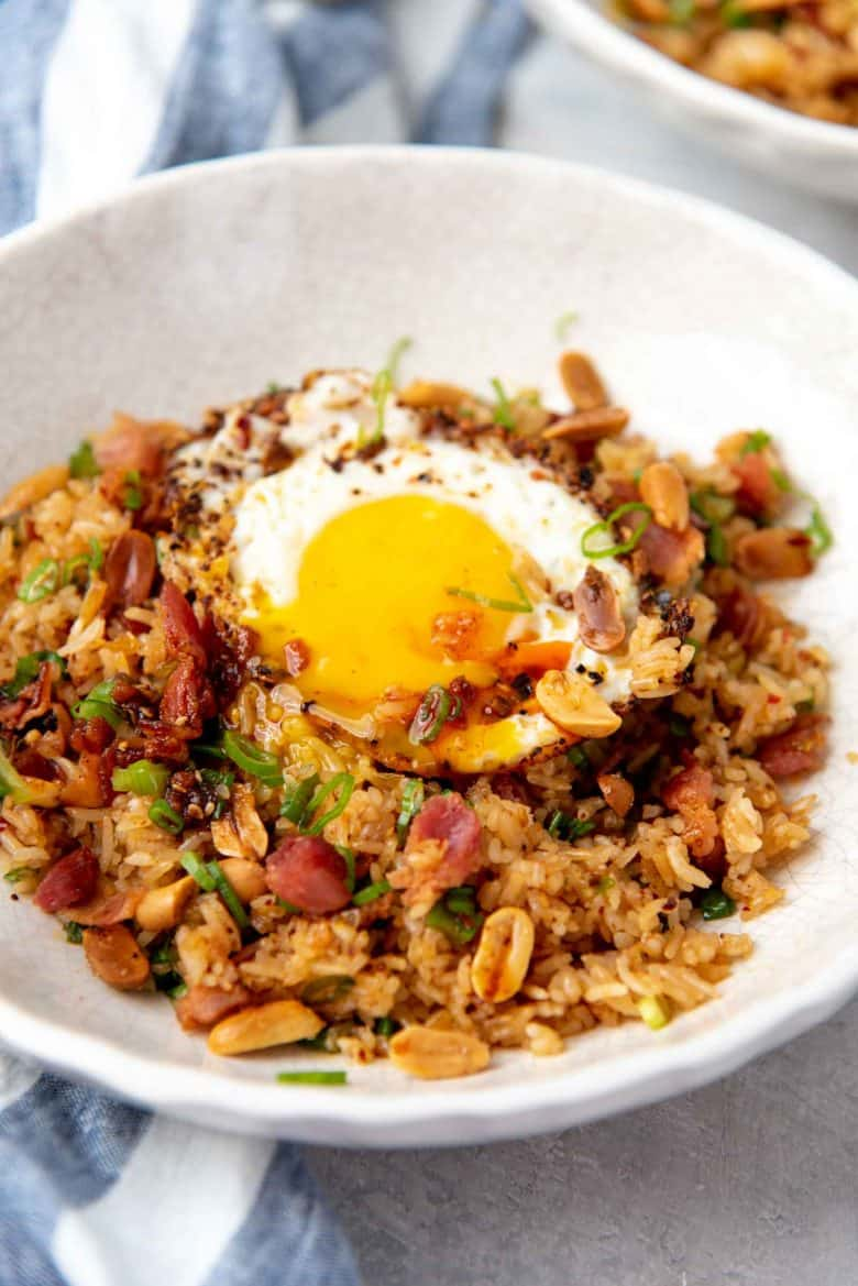 A close up of the fried rice, with the runny yolk mixing in with the rice