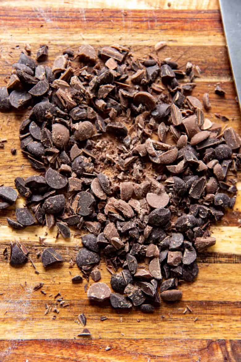Chopped chocolate chips on a chopping block