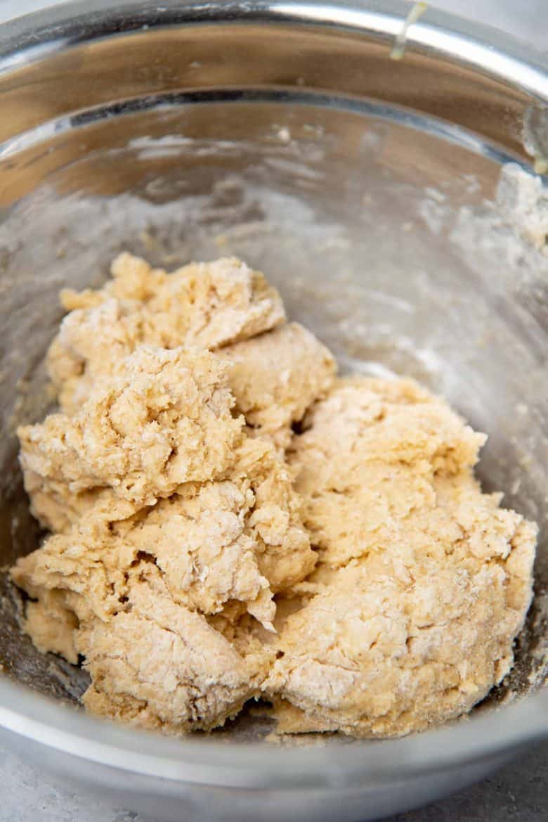 Forming a scraggly dough that's rough and sticky in the mixing bowl