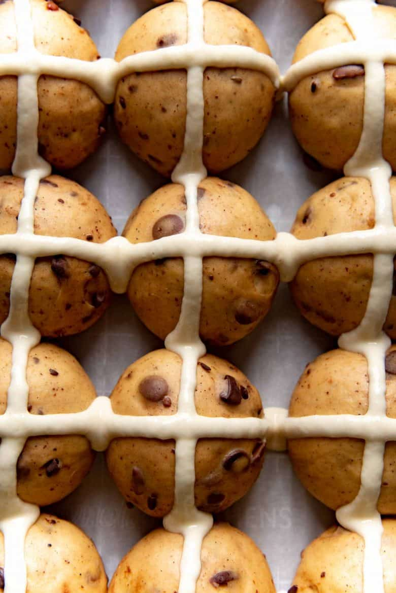 An overhead view of the chocolate chip hot cross buns with the flour paste crosses piped on top.