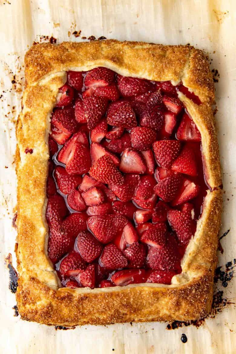 An iverhead view of a freshly baked strawberry galette