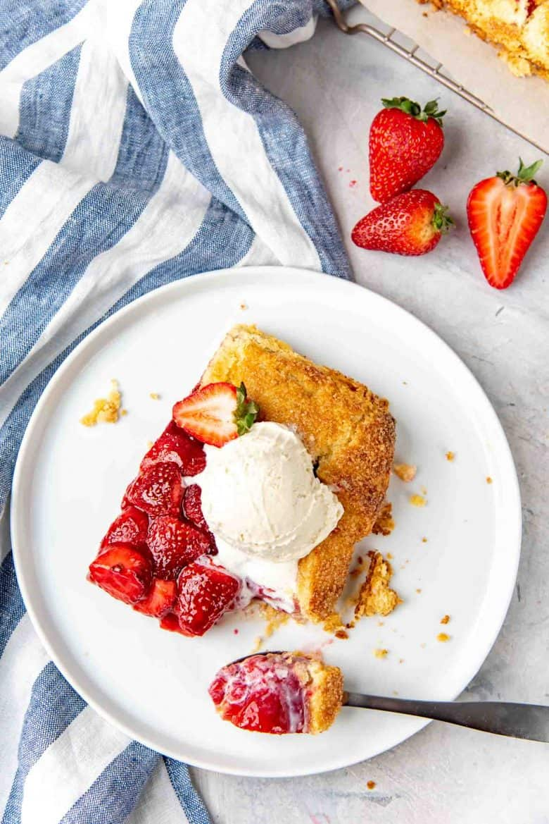 An overhead view of the strawberry galette slice with a scoop of ice cream