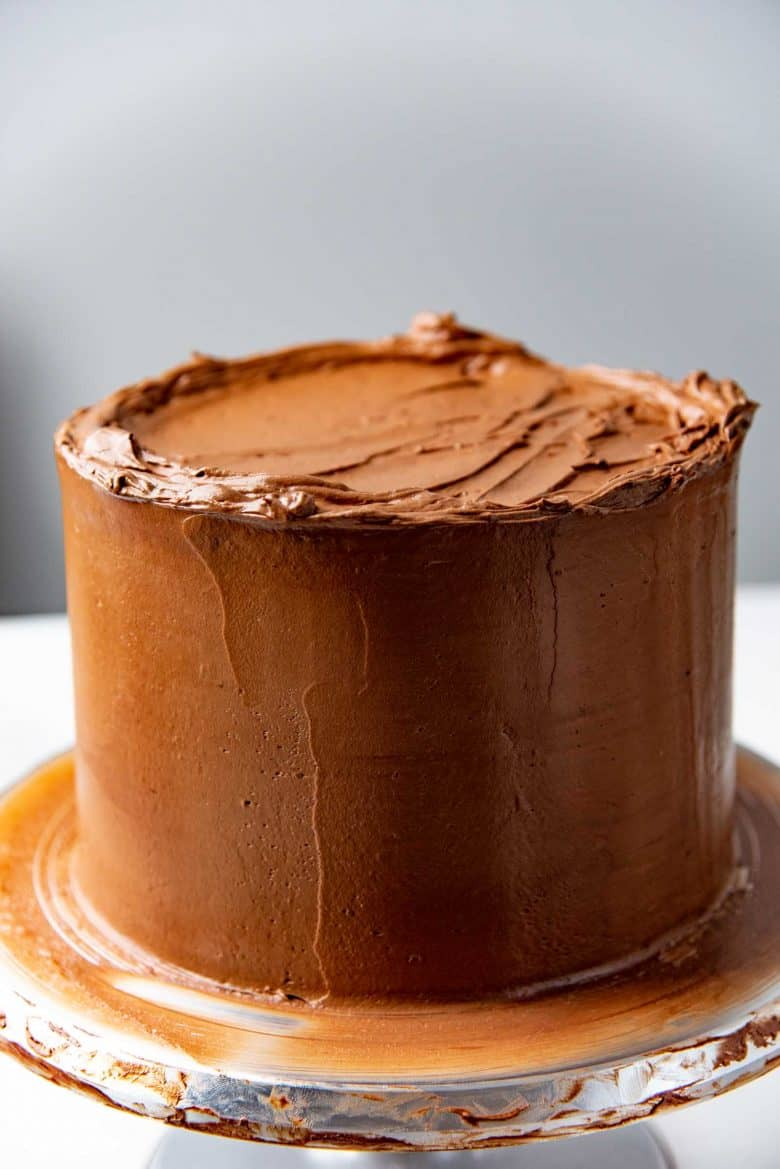The devil's food cake with the frosting layer smooth on the sides