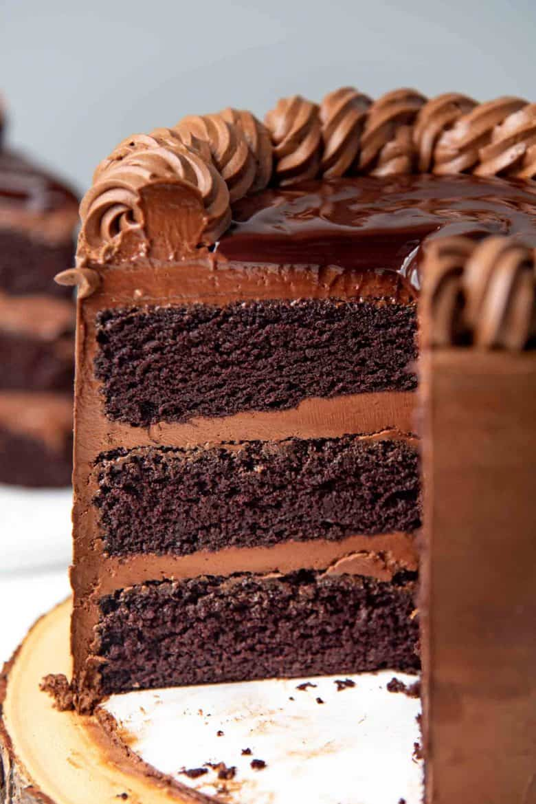 A view of the inside of the devil's food cake, showing three cake layers with even chocolate frosting in between