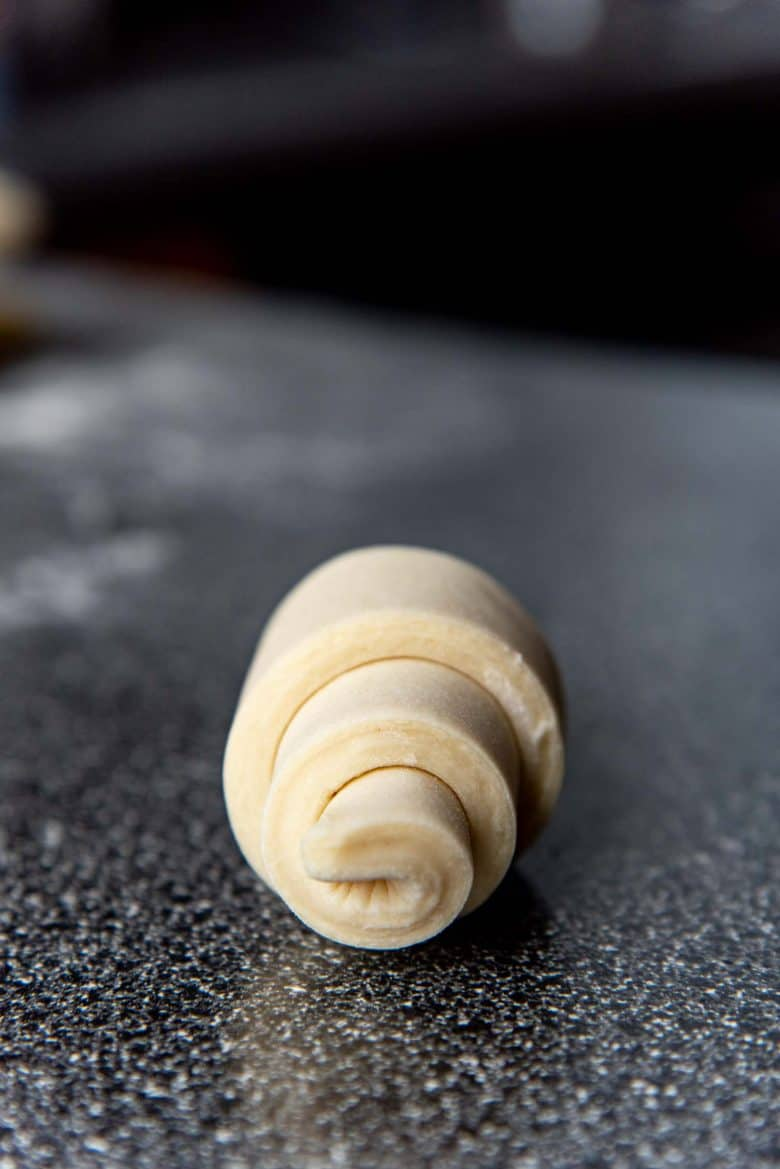 A side view of a rolled up croissant