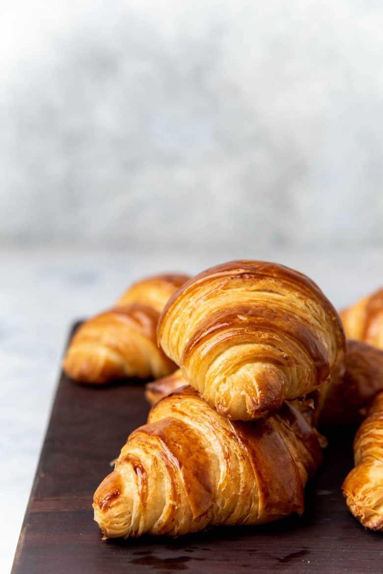 Croissants served on a wooden block