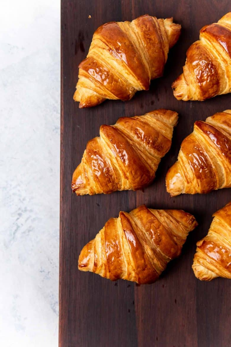 An overhead view of the croissants on a serving block