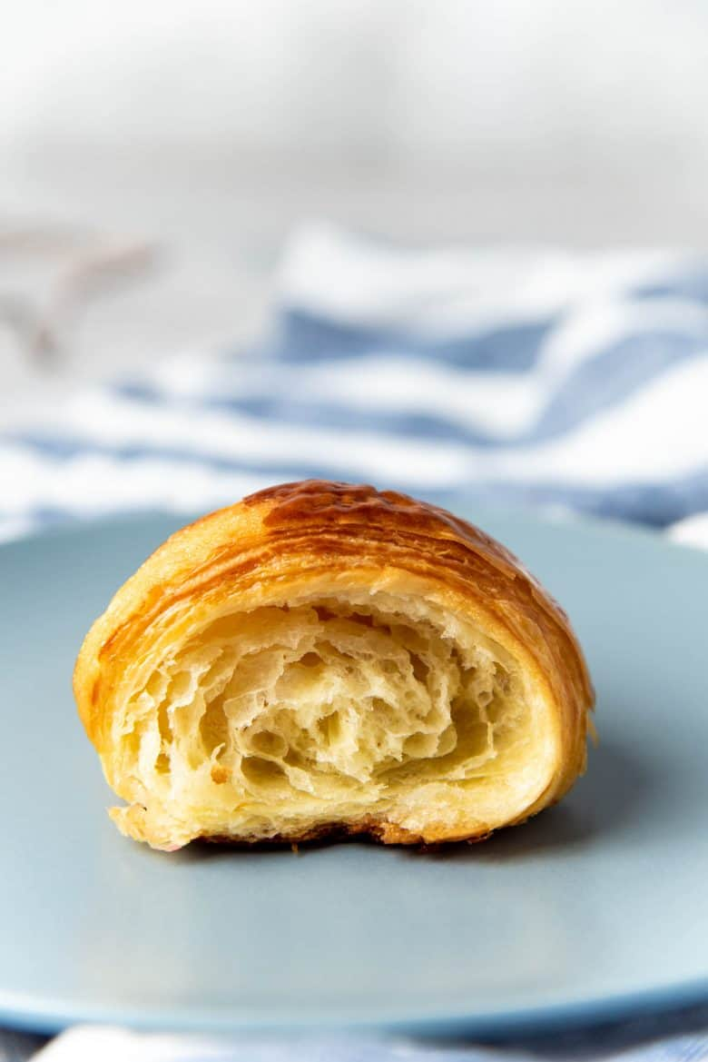 A croissant half on the plate