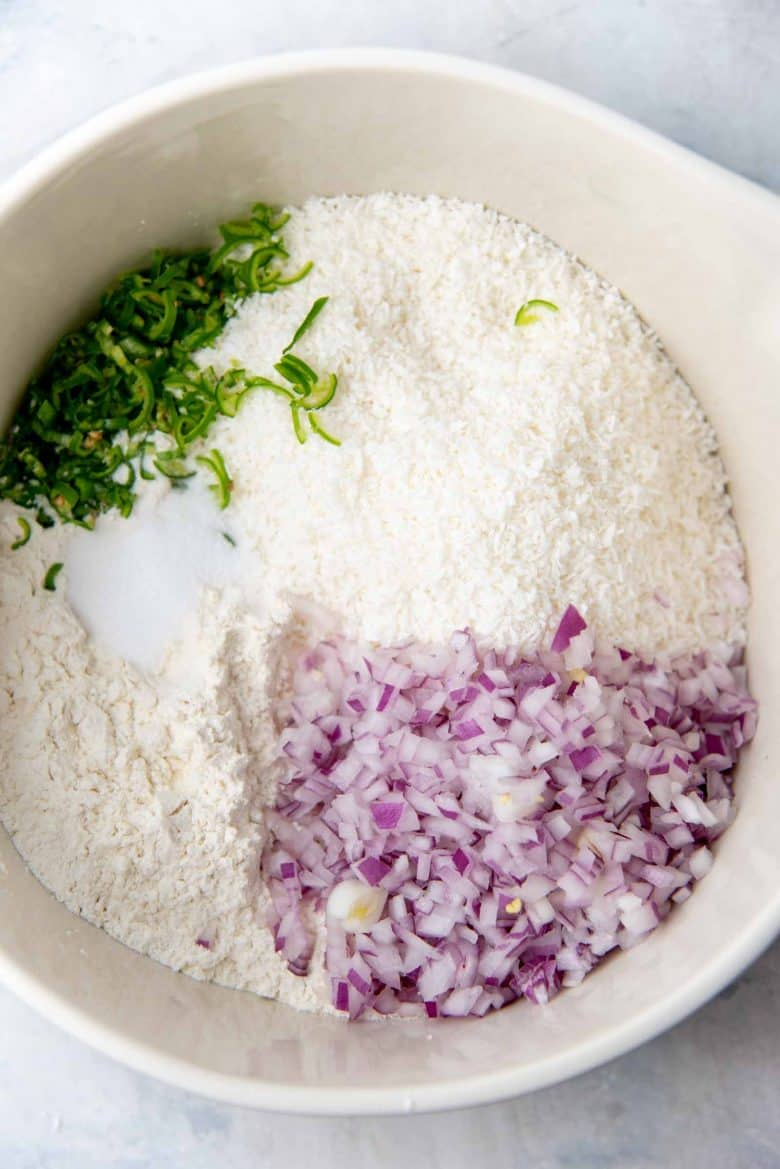 Chopped red onions, green chili and salt added to the flour coconut mix to make Pol Roti