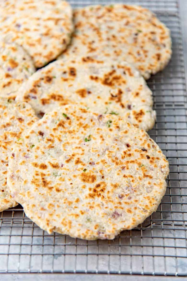 Cooked coconut flatbread cooling on a wire rack