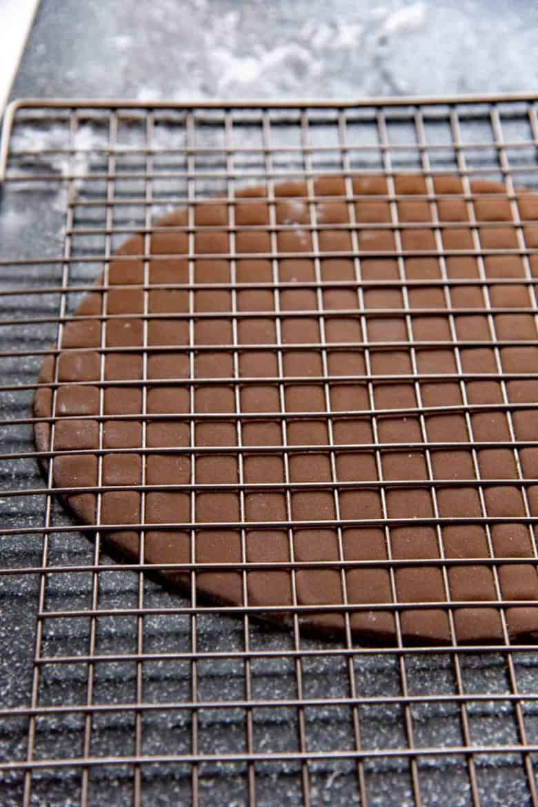 Press down on the dough using a cooling rack to form squared