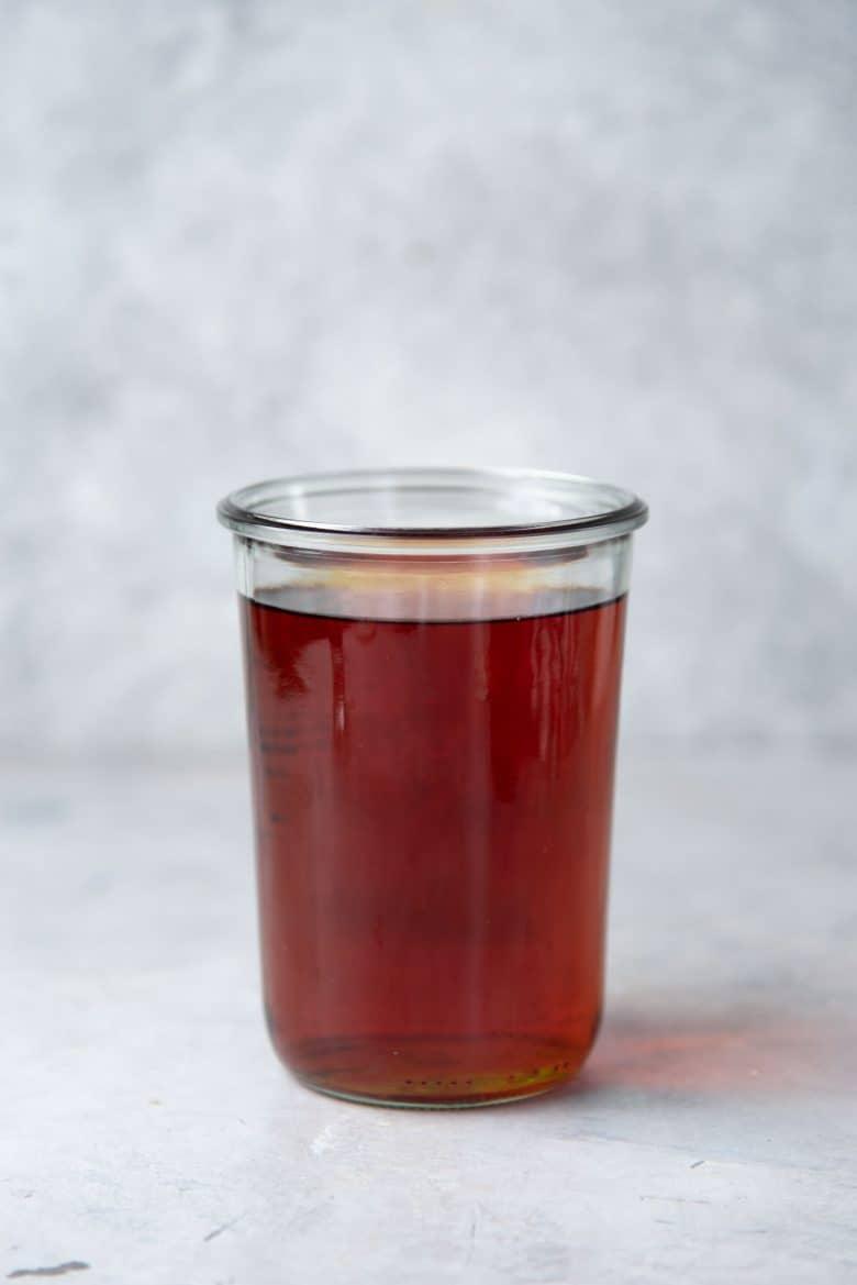 Brewed black tea in a large glass jar