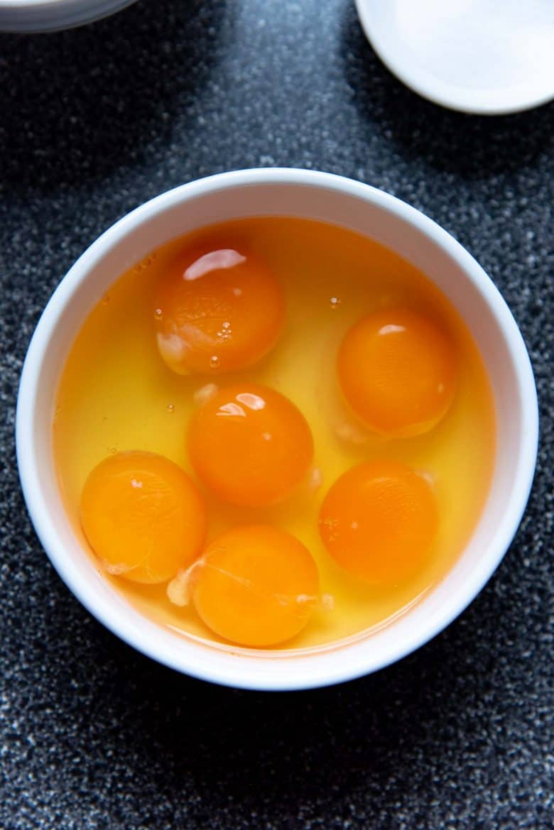 Eggs in a white bowl, to be used for brioche