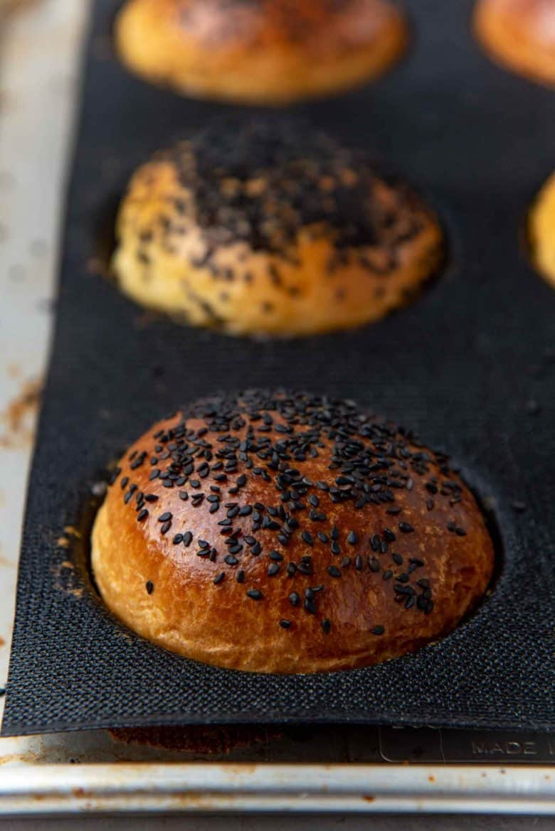 Freshly baked buns with black sesame seeds