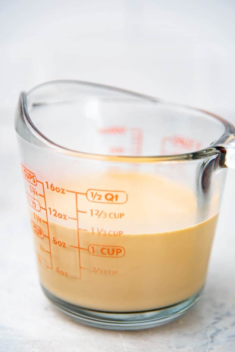 Strained milk tea concentrate in a jug to make panna cotta
