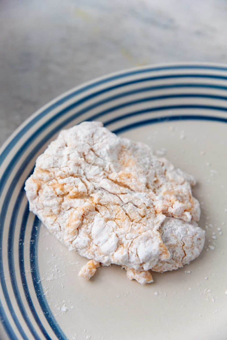 A chicken thigh piece coated with potato starch