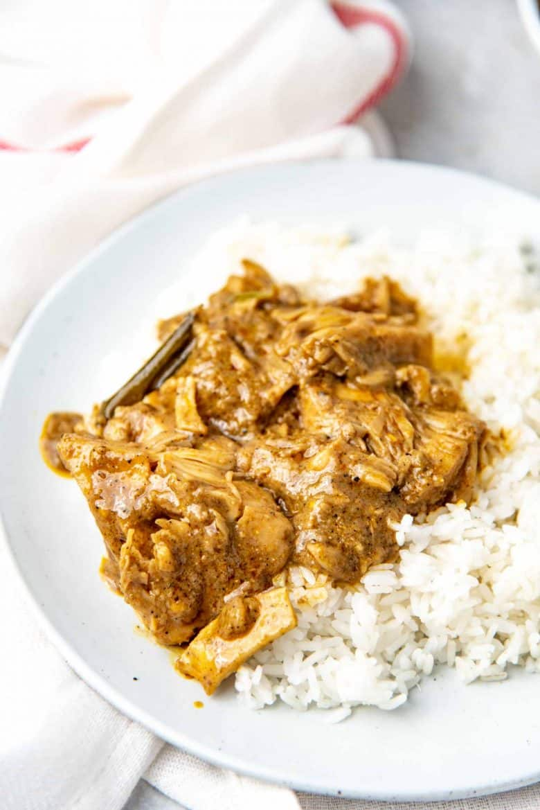 The jackfruit curry served with white rice on a plate
