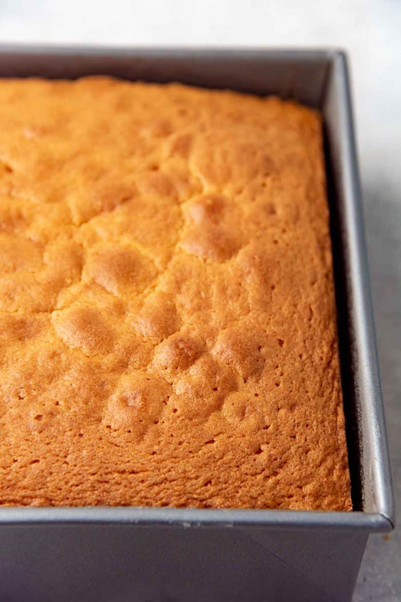A freshly baked sri lankan butter cake, still in the cake pan