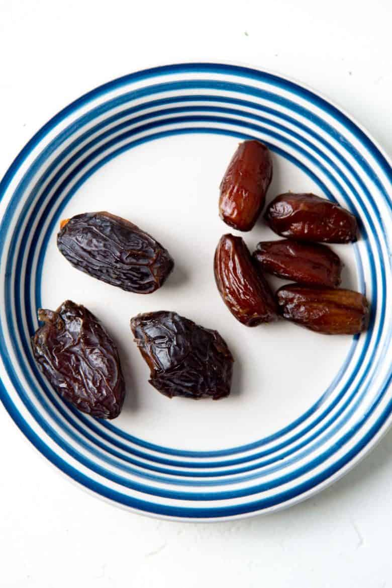 medjool dates and deglet noor dates on a plate to show differences
