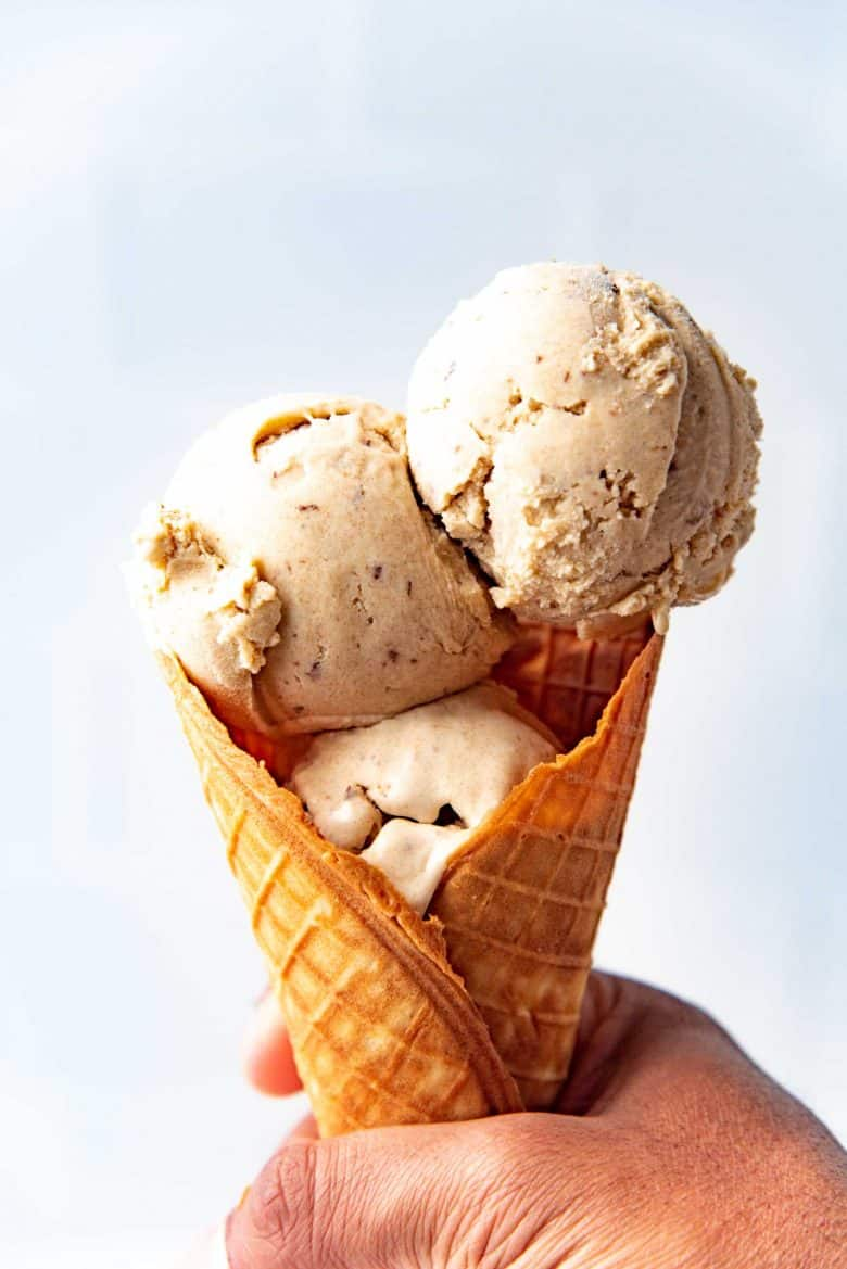 three scoops of tahini and date ice cream in a homemade waffle cone