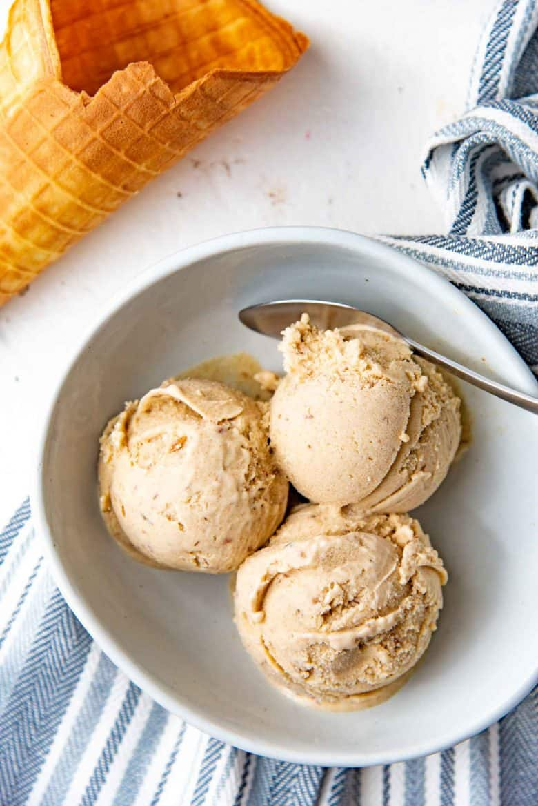 three scoops of ice cream in a bowl, overhead phtograph