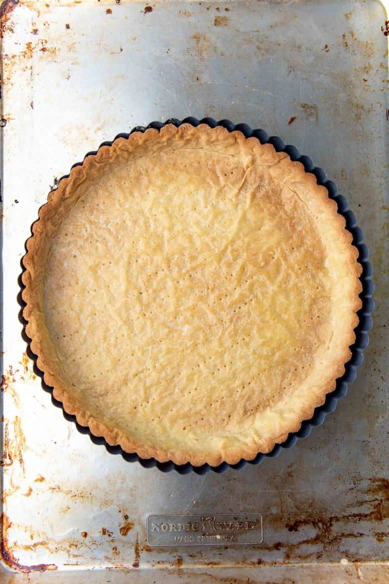 A golden brown baked pate sucree tart