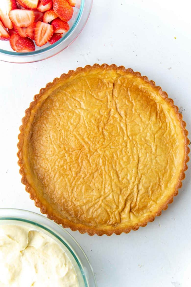 Egg washed tart shell with a golden brown sheen