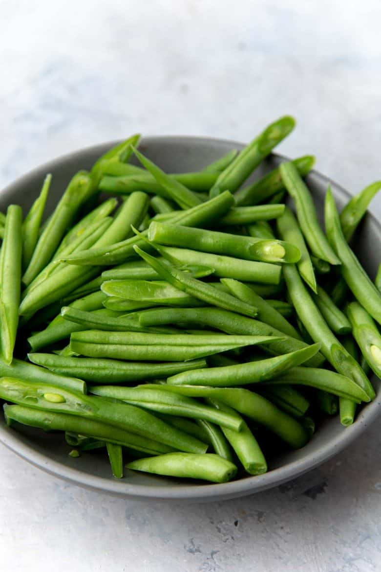Fresh green beans cut at a diagonal