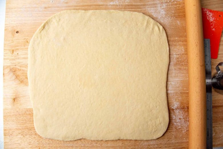 Japanese milk bread dough rolled out into a square