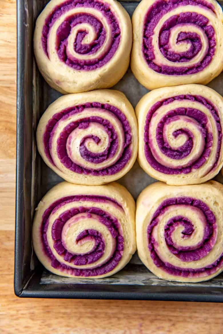 Proofed ube rolls in the baking pan